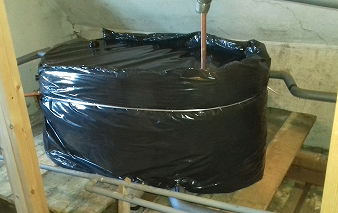 Water Tank with lagging in loft